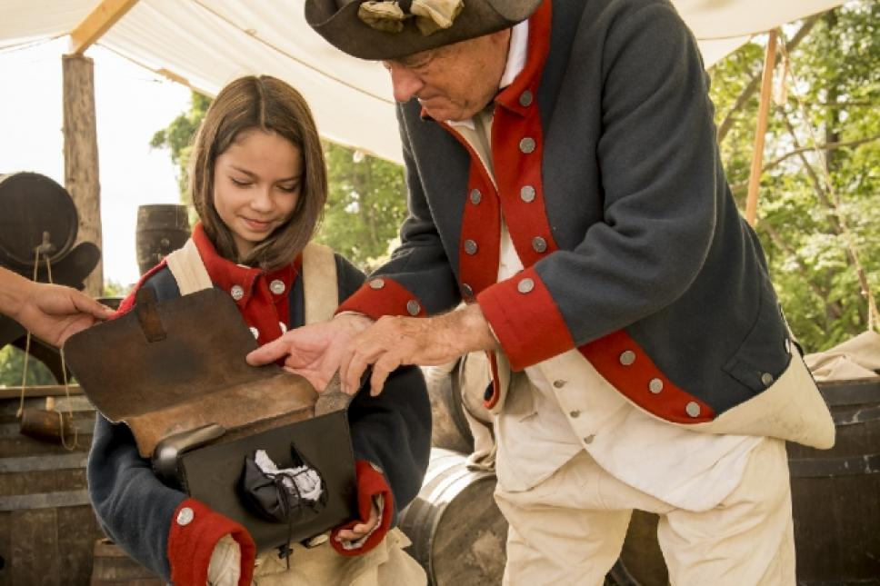 Exploring a Continental Army soldier's haversack at the American Revolution Museum at Yorktown.
