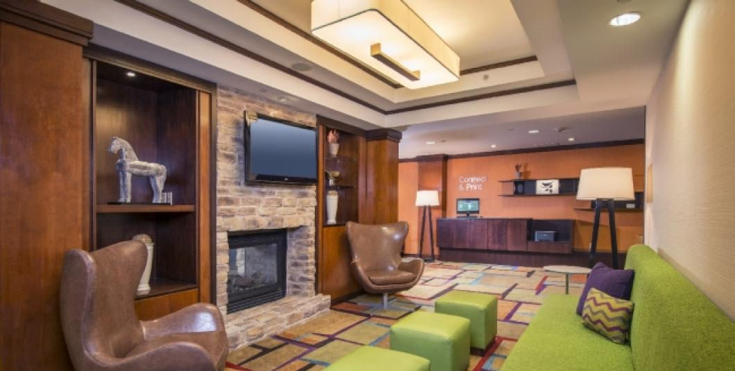 Enjoy time with family and friends in the Fairfield Inn & Suites hotel's well-appointed lobby.