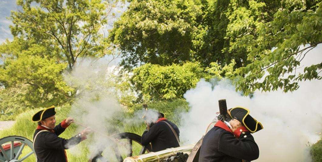 Artillery firing in the re-created Continental Army encampment at the American Revolution Museum at Yorktown.