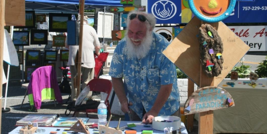 Famed Richmond folk artist Tom Blunt sets up for the first Art in the 'Burg held in Spring 2015