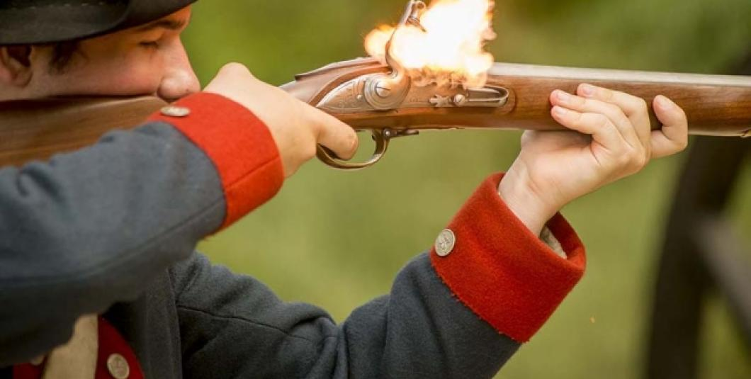 Flintlock musket firing at the American Revolution Museum at Yorktown