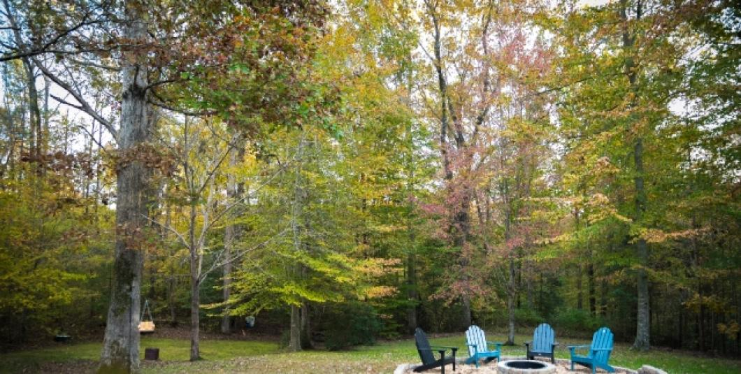 Fire pit and nature trails on property