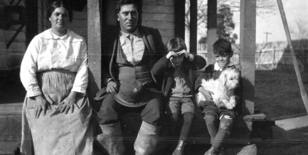 In 1919, Pamunkey Indian couple Nannie and Paul Miles, along with an unidentified child and Union Ottaway Collins holding a dog, posed on the front porch of a house on the Pamunkey Reservation in Virginia. Frank Speck photograph collection, N12730; National Museum of the American Indian Archive Cent