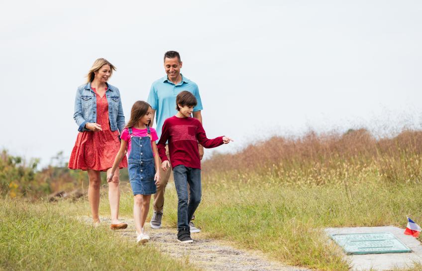Family Walks Down a Path in Yorktown