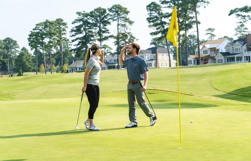 Couple High Fives on Golf Course