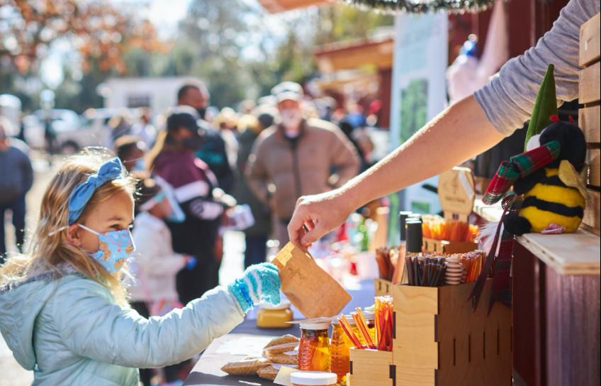 Girl Wearing Masks Picks Out Treats Williamsburg Christmas Market