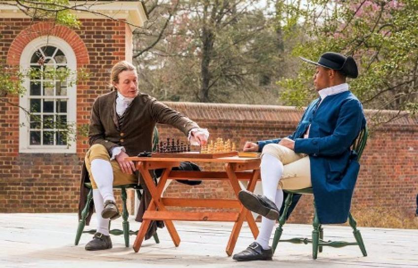 Black Man and White Man Play Chess