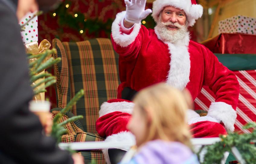 Santa Claus Waves at Williamsburg Christmas Market
