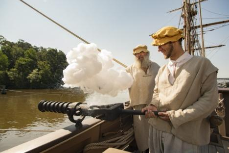 Firing swivel gun on board Jamestown Settlement's Discovery.
