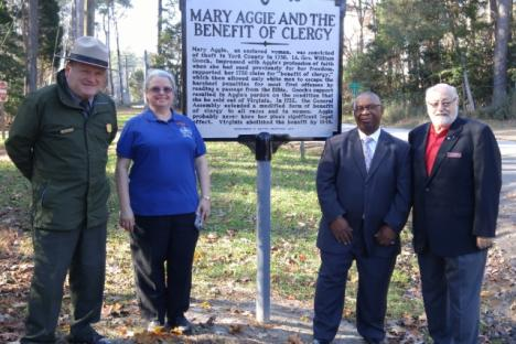 Members of the Historical Museum, Historical Committee, and National Park Sevice with a recently installed historical marker near the Yorktown Battlefield
