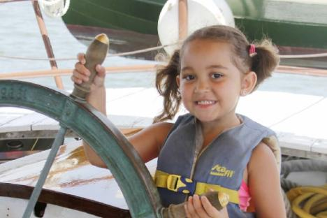 Girl at the helm