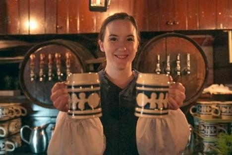 Mugs of ale being served in Chowning's Tavern, Colonial Williamsburg's authentic 18th-century alehouse